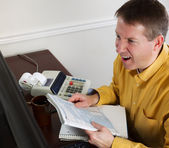 Mature Man goes into rage while work on his Taxes — Stock Photo