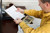 Mature Man looking at Tax Form Print Out — Stock Photo