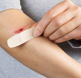 Treating Cut on Arm — Stock Photo