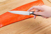Preparing to Cut Wild Red Salmon for Cooking — Foto Stock