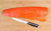 Red Salmon with Cutting Knife on Board — Stok fotoğraf