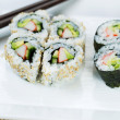 Stock Photo: Top view shot of California Rolls in white plate
