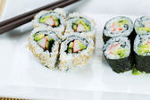Top view shot of California Rolls in white plate — Stock Photo
