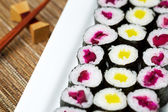 Large plated filled with Pickled Hand Rolled Sushi — Stock Photo