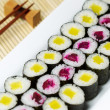 Stock Photo: Fresh Hand Rolled Pickled Sushi in Large White Plate
