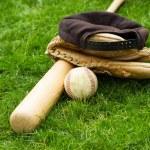 Old Baseball Equipment on Grass Field — Stock Photo #45374547
