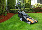 Electric Battery Lawn Mower on Front Yard  — Stock Photo