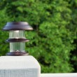 Solar lamp placed on patio post  — Stock Photo #45992635