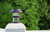 Solar lamp placed on patio post  — Foto de Stock
