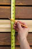 Measuring space between boards  — Stock Photo