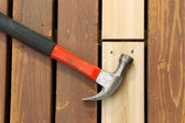 Used Hammer on top of new installed board — Stock Photo