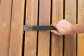 Removing old wooden boards with Pry Bar  — Stock Photo