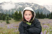 Young Girl hiking outdoors during early spring in the mountains  — Stock Photo