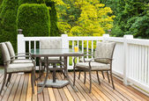 Outdoor Furniture on Cedar Wood Patio during nice day — Stock Photo