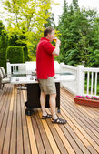 Mature Man relaxing by drinking beer on outdoor patio  — Foto Stock