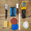 Sanding and Painting Accessories on Faded Wooden Boards — Stock Photo
