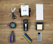 Basic Office Supplies on Aged Wood  — Stock Photo