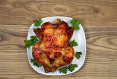 Fresh Oven Roasted Whole Chicken with Parsley on Serving Plate — Stock Photo