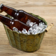 Cold Beer Bottles in Metal Bucket filled with Ice — Stock Photo #48118453