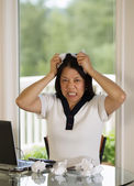 Mature woman ripping work papers in Anger  — Stock Photo