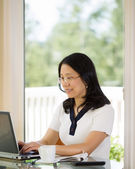 Happy Mature woman working from Home — Stock Photo
