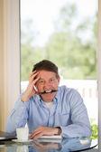 Mature man stressed at work  — Stock Photo