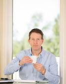 Mature Man enjoying coffee while at work  — Stock Photo