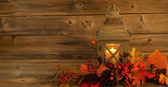 Traditional Asian Lantern with autumn Decorations on Rustic Wood — Stockfoto
