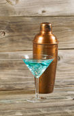 Mixed drink and Metal Mixer on Rustic Wood  — Stockfoto