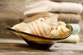 Seashells and Towels on Rustic Wood  — Stock Photo
