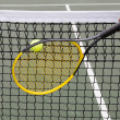 Tennis Ball into Net during game — Stock Photo