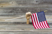 Wooden Hand holding American Flag  — Stock Photo