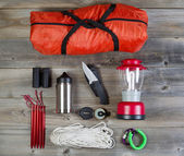 Camping Gear on Rustic Wooden Boards  — Stock Photo