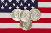 American Silver Dollars and USA Flag  — Stock Photo
