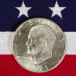 Eisenhower Silver Dollar on American Flag — Stock Photo #49616619