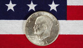 Eisenhower Silver Dollar on American Flag  — Stock Photo