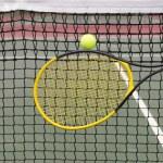 Player hits tennis ball into net — Stock Photo