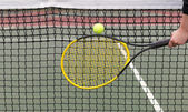 Player hits tennis ball into net — Stockfoto