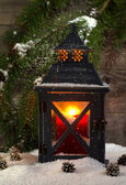 Metal Lantern with Glowing Candle during the holiday season — Stock Photo