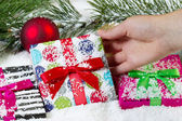 Handing Picking up Holiday Wrapped Gift for Christmas — Stockfoto