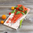 Wild Salmon and ingredients on wooden Plank for cooking — Stock Photo #50249503