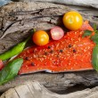 Wild Salmon Fillet placed inside of diftwood — Stock Photo #50249539