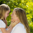 Mother and daughter sharing a moment together outdoors — Stock Photo #50675637