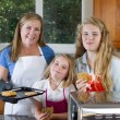 Family of Girls of eating freshly baked cookies — Stock Photo #50910469