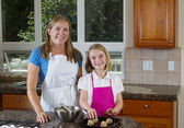 Happy mother and daughter making cookies  — Foto Stock