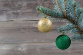 Holiday Ornaments hanging from Blue Spruce Tree Branch  — Stock Photo