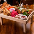 Tasty food on a wooden table — Stock Photo