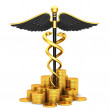 Black caduceus medical symbol and gold coins — Stock Photo