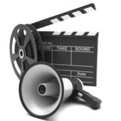 Movie clapper and film strip — Stock Photo
