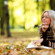 Woman read in park - Stock Photo